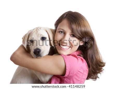 Beautiful young woman  embracing a cute dog - stock photo