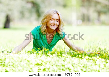 Beautiful young woman enjoy spring nature - stock photo