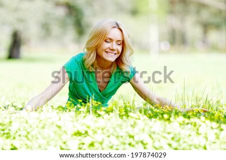 Beautiful young woman enjoy spring nature - stock photo