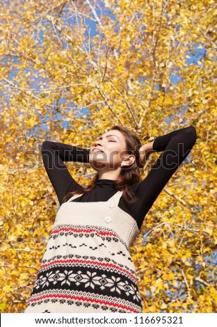 Beautiful young woman enjoyed sunny autumn day - stock photo