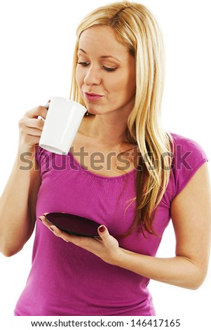 Beautiful young woman enjoying a cup of coffee.  Isolated on white background.  - stock photo