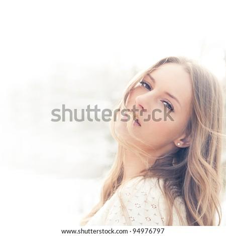 beautiful young woman enjoying a sunny day - stock photo
