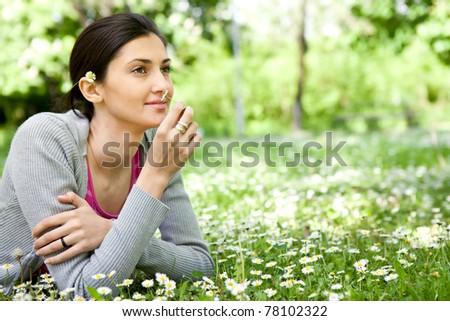 beautiful young woman enjoying in nature - stock photo