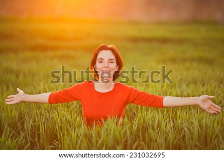 Beautiful young woman enjoying nature - stock photo