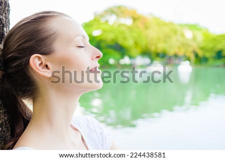 Beautiful young woman enjoying nature. Freedom concept. Enjoyment - stock photo