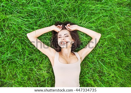 Beautiful young woman enjoying summer