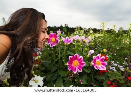 Beautiful young woman enjoying the gardens in Paris, France. - stock photo