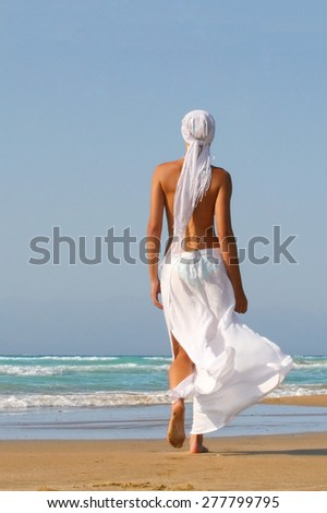 Beautiful young woman enjoying the Ionian sea in Greece - stock photo