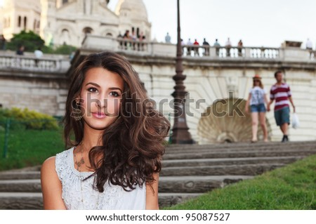 Beautiful young woman enjoying the Montmartre area in Paris, France. - stock photo