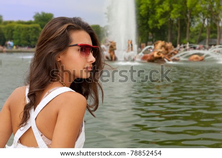 Beautiful young woman enjoying the sights in Paris, France. - stock photo