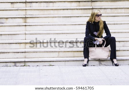 Beautiful young woman executive in the city - stock photo