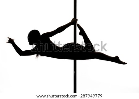 Beautiful young woman exercise pole dance against a white background studio shot