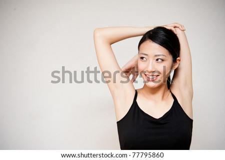 beautiful young woman exercising in the room - stock photo