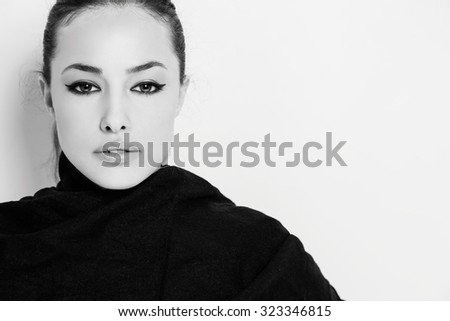 beautiful young woman face, black and white studio portrait