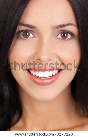 Beautiful young woman face. Close up. - stock photo