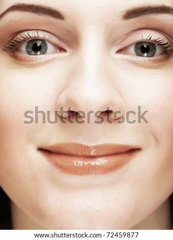 Beautiful young woman face. Close up.