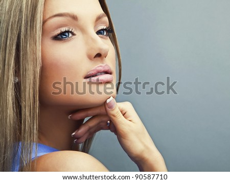 Beautiful Young Woman Face. Close-up studio portrait with copy-space. - stock photo