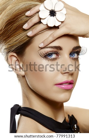 beautiful young woman face close-up wearing bright pink lipstick and long false eyelashes with glitter and a large flower cocktail ring. - stock photo