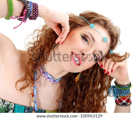 beautiful young woman face close up with hippie art make up and false eyelashes - stock photo