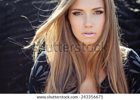 Beautiful young woman face closeup - stock photo