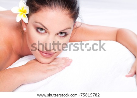 beautiful young woman face closeup in spa salon - stock photo