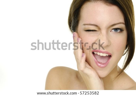 Beautiful young woman face cool Close up. - stock photo