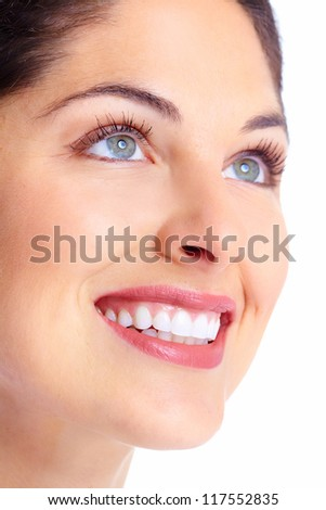 Beautiful young woman face. Dental health. - stock photo