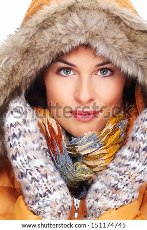 Beautiful young woman face. Winter clothing. - stock photo