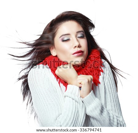 beautiful young woman feeling cold wind in winter hearing warm closthes isolated over white - stock photo