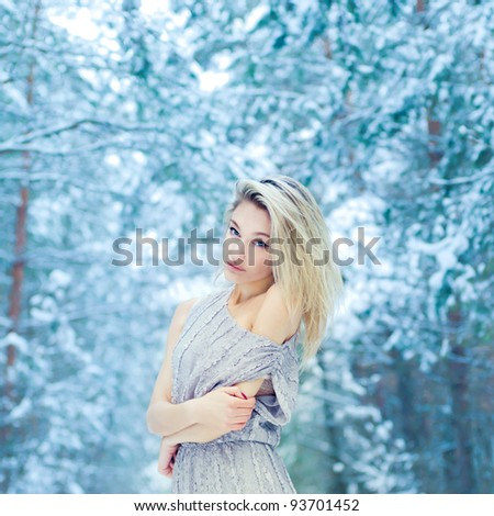 beautiful young woman freezes in winter park - stock photo