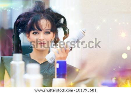 Beautiful young woman gets a hairdo in the beauty-shop - stock photo