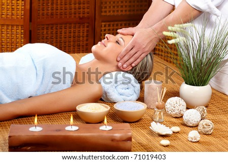 Beautiful young woman getting a massage - stock photo