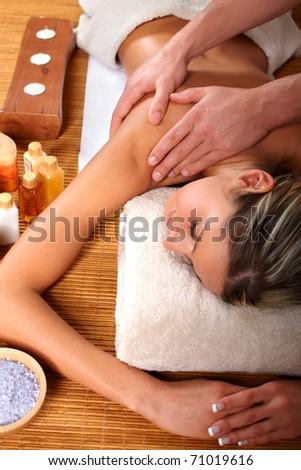 Beautiful young woman getting a massage - stock photo