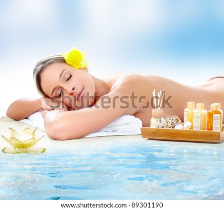 Beautiful young woman getting spa massage. - stock photo
