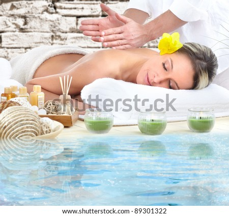 Beautiful young woman getting spa massage.