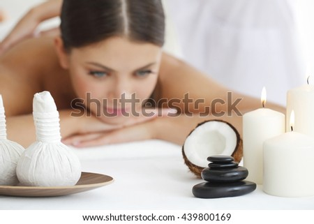 Beautiful young woman getting spa massage close up - stock photo