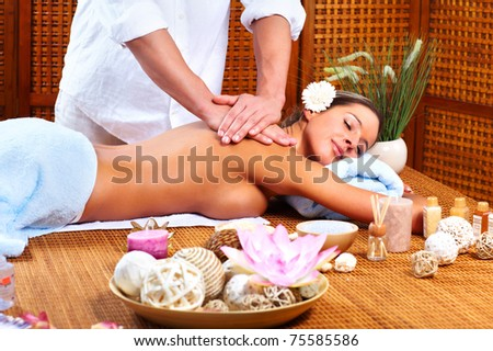 Beautiful young woman getting spa massage. Health. - stock photo