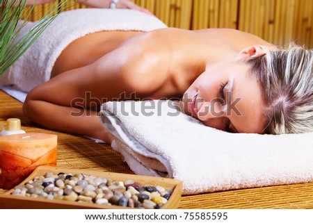 Beautiful young woman getting spa massage. Health.