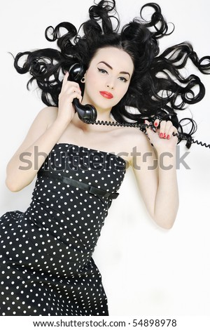 beautiful young woman girl talking on old phone isolated on white in studio - stock photo