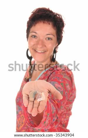 Beautiful young woman giving Hearing Aid - stock photo