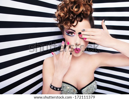 Beautiful young woman glam rock style fashion and make up - stock photo