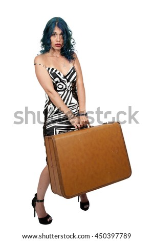 Beautiful young woman going on vacation with a suitcase - stock photo
