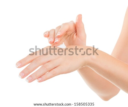 Beautiful young woman hands with cream, isolated on white - stock photo