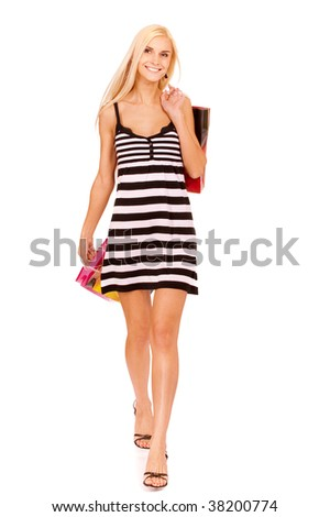 Beautiful young woman has made shopping and comes back home with purchases, it is isolated on white background. - stock photo