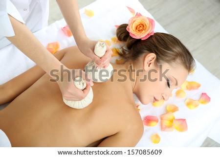 Beautiful young woman having back massage close up - stock photo