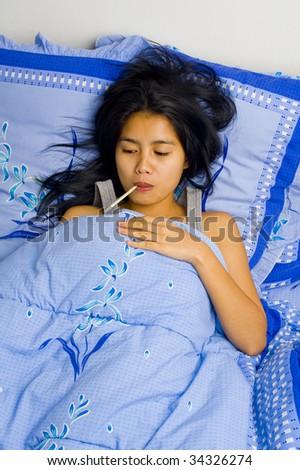 beautiful young woman having fever. - stock photo