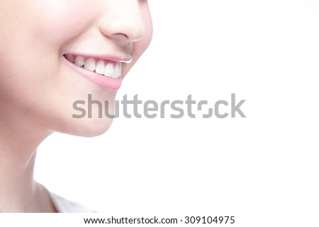 Beautiful young woman health teeth close up and charming smile. Isolated over white background, asian beauty - stock photo