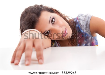 beautiful young woman, her head resting on his arm, isolated on white background. Studio shot - stock photo