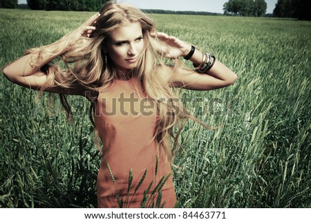 Beautiful young woman hippie posing outdoor. - stock photo