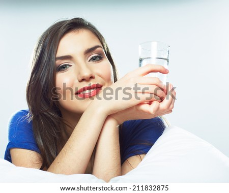 Beautiful young woman hold water glass. Drink water.